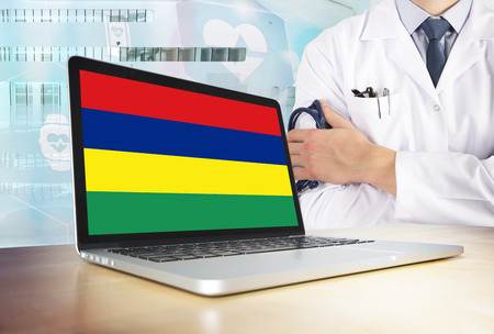 Mauritius healthcare system in tech theme. Mauritian flag on computer screen. Doctor standing with stethoscope in hospital. Cryptocurrency and Blockchain concept.
