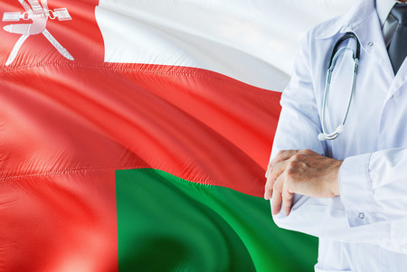 Omani Doctor standing with stethoscope on Oman flag background. National healthcare system concept, medical theme.