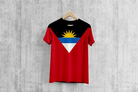 Antigua and Barbuda flag T-shirt on hanger, team uniform design idea for garment production. National wear. 3D Rendering.