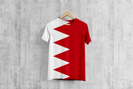 Bahrain flag T-shirt on hanger, Bahraini team uniform design idea for garment production. National wear. 3D Rendering. Stock Photo