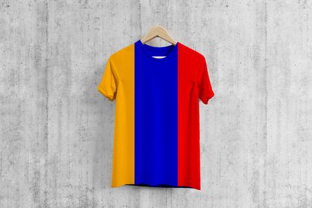 Armenia flag T-shirt on hanger, Armenian team uniform design idea for garment production. National wear. 3D Rendering.