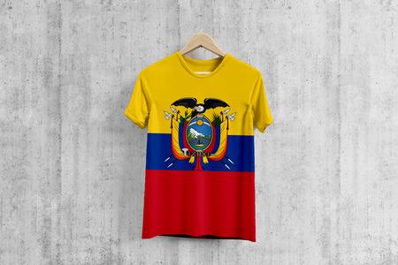 Ecuador flag T-shirt on hanger, Ecuadorean team uniform design idea for garment production. National wear. 3D Rendering.