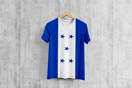 Honduras flag T-shirt on hanger, Honduran team uniform design idea for garment production. National wear.