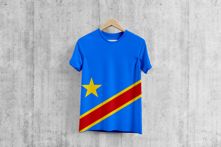 Congo flag T-shirt on hanger, Congolese team uniform design idea for garment production. National wear. 3D Rendering.