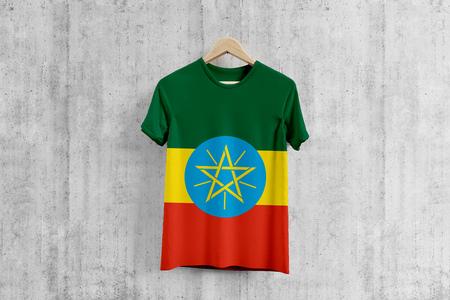 Ethiopia flag T-shirt on hanger, Ethiopian team uniform design idea for garment production. National wear. 3D Rendering. Stock Photo
