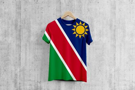 Namibia flag T-shirt on hanger, Namibian team uniform design idea for garment production. National wear. Stock fotó