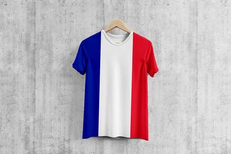 France flag T-shirt on hanger, French team uniform design idea for garment production. National wear. 3D Rendering.