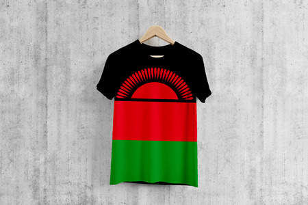 Malawi flag T-shirt on hanger, Malawian team uniform design idea for garment production. National wear. Stock fotó