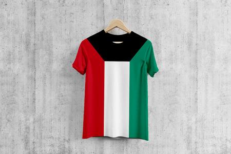 Kuwait flag T-shirt on hanger, Kuwaiti team uniform design idea for garment production. National wear. Stock Photo