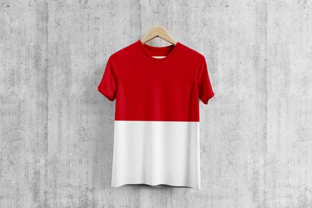 Monaco flag T-shirt on hanger, Monegasque team uniform design idea for garment production. National wear.