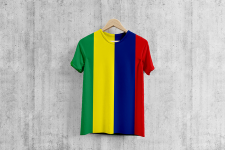 Mauritius flag T-shirt on hanger, Mauritian team uniform design idea for garment production. National wear. Stock Photo