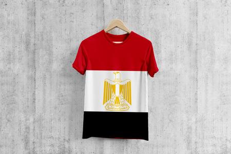 Egypt flag T-shirt on hanger, Egyptian team uniform design idea for garment production. National wear. 3D Rendering.