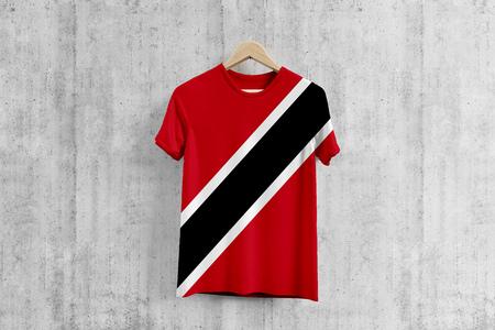 Trinidad And Tobago flag T-shirt on hanger, team uniform design idea for garment production. National wear.