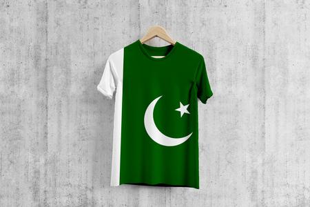 Pakistan flag T-shirt on hanger, Pakistani team uniform design idea for garment production. National wear. Stock fotó