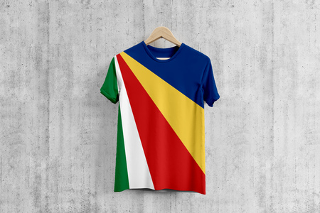 Seychelles flag T-shirt on hanger, Seychellois team uniform design idea for garment production. National wear.