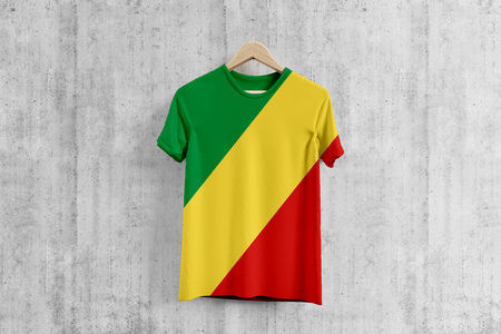 Republic Of The Congo flag T-shirt on hanger, Congolese team uniform design idea for garment production. National wear. Stock Photo