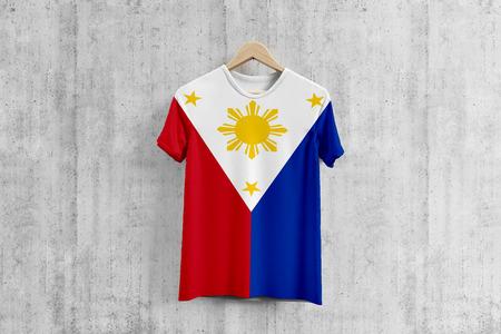 Philippines flag T-shirt on hanger, Filipino team uniform design idea for garment production. National wear. Stock fotó