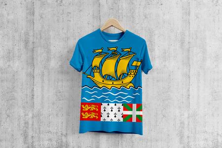 Saint Pierre And Miquelon flag T-shirt on hanger, team uniform design idea for garment production. National wear.
