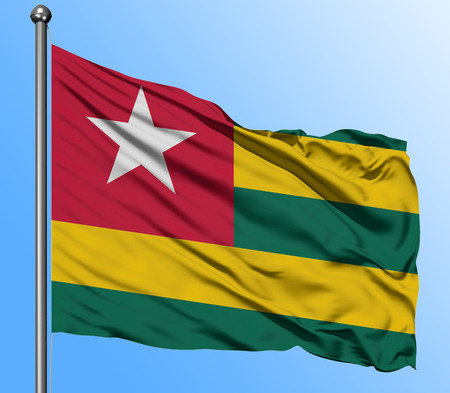 Togo flag waving in the deep blue sky background. Isolated national flag. Macro view shot. Standard-Bild