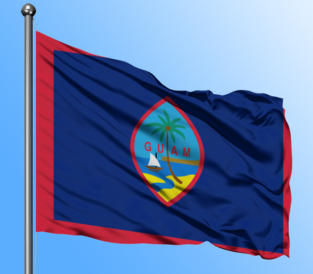 Guam flag waving in the deep blue sky background. Isolated national flag. Macro view shot.