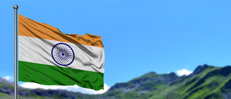 India flag waving in the blue sky with green fields at mountain peak background. Nature theme. Foto de archivo