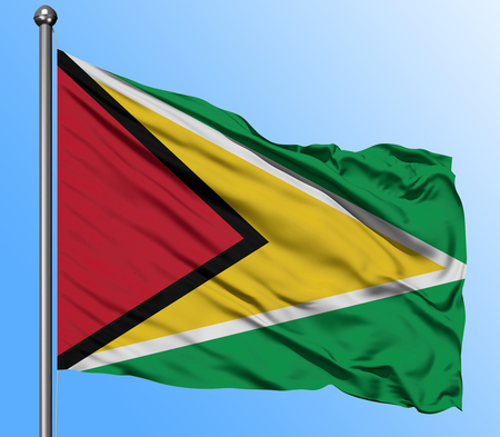 Guyana flag waving in the deep blue sky background. Isolated national flag. Macro view shot.
