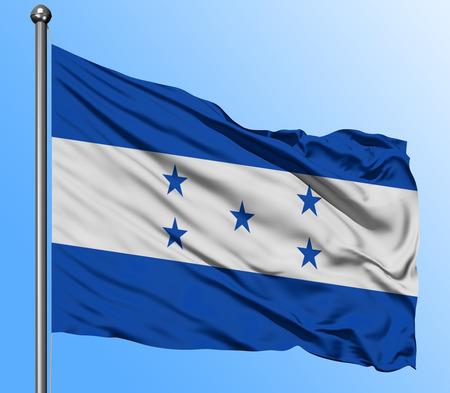 Bandera de Honduras ondeando en el fondo de cielo azul profundo. Bandera nacional aislada. Tiro de vista macro.