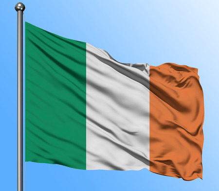 Ireland flag waving in the deep blue sky background. Isolated national flag. Macro view shot. Stock Photo