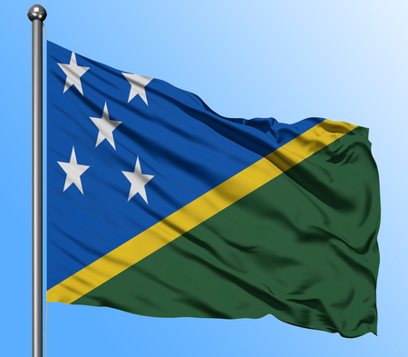 Solomon Islands flag waving in the deep blue sky background. Isolated national flag. Macro view shot.