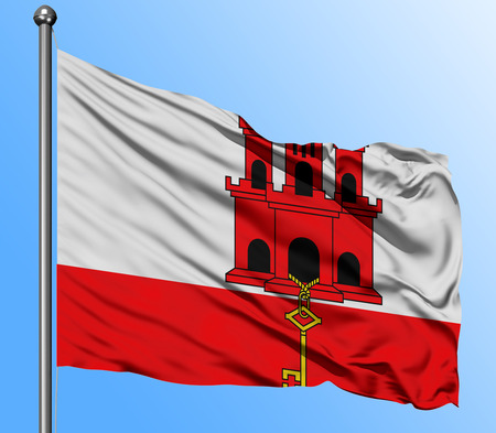 Gibraltar flag waving in the deep blue sky background. Isolated national flag. Macro view shot.