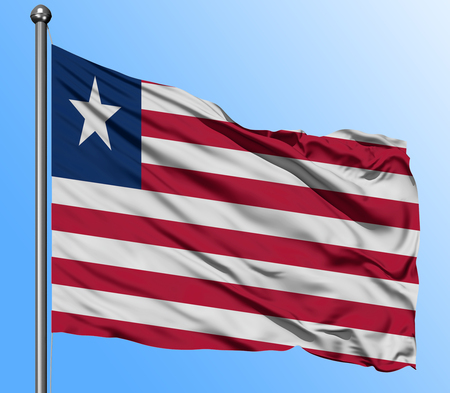 Liberia flag waving in the deep blue sky background. Isolated national flag. Macro view shot.