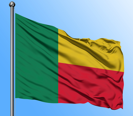 Benin flag waving in the deep blue sky background. Isolated national flag. Macro view shot.