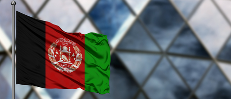 Afghanistan flag waving in the wind against blurred modern building. Business concept. National cooperation theme. Stok Fotoğraf
