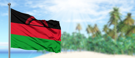 Waving Malawi flag in the sunny blue sky with summer beach background. Vacation theme, holiday concept.