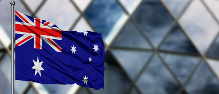 Australia flag waving in the wind against blurred modern building. Business concept. National cooperation theme. Stock fotó