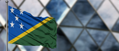 Solomon Islands flag waving in the wind against blurred modern building. Business concept. National cooperation theme. Stok Fotoğraf