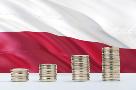Poland flag waving in the background with rows of coins for finance and business concept. Saving money. Stock Photo
