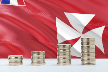 Wallis And Futuna flag waving in the background with rows of coins for finance and business concept. Saving money.
