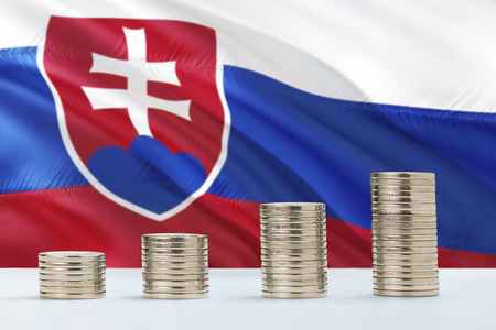 Slovakia flag waving in the background with rows of coins for finance and business concept. Saving money.