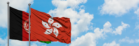Afghanistan and Hong Kong flag waving in the wind against white cloudy blue sky together. Diplomacy concept, international relations.