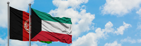 Afghanistan and Kuwait flag waving in the wind against white cloudy blue sky together. Diplomacy concept, international relations.