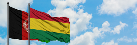 Afghanistan and Bolivia flag waving in the wind against white cloudy blue sky together. Diplomacy concept, international relations.