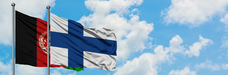 Afghanistan and Finland flag waving in the wind against white cloudy blue sky together. Diplomacy concept, international relations. Standard-Bild