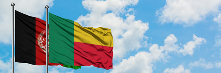 Afghanistan and Benin flag waving in the wind against white cloudy blue sky together. Diplomacy concept, international relations.