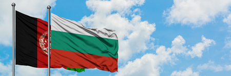 Afghanistan and Bulgaria flag waving in the wind against white cloudy blue sky together. Diplomacy concept, international relations. Standard-Bild