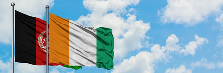 Afghanistan and Cote D'Ivoire flag waving in the wind against white cloudy blue sky together. Diplomacy concept, international relations.
