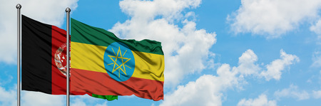 Afghanistan and Ethiopia flag waving in the wind against white cloudy blue sky together. Diplomacy concept, international relations.