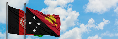 Afghanistan and Papua New Guinea flag waving in the wind against white cloudy blue sky together. Diplomacy concept, international relations.