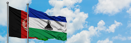 Afghanistan and Lesotho flag waving in the wind against white cloudy blue sky together. Diplomacy concept, international relations.