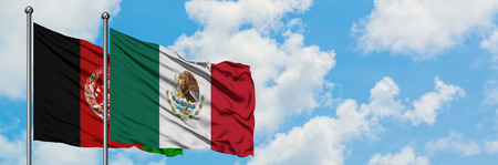 Afghanistan and Mexico flag waving in the wind against white cloudy blue sky together. Diplomacy concept, international relations.
